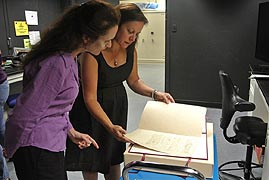 [photo, Dr. Fenella France, Chief, Preservation Research & Testing Division, Library of Congress, & Vicki Lee, Director, Conservation & Preservation, examining George Washington letter of resignation prior to hyperspectral imaging, Conservation Lab, State Archives, Annapolis, Maryland]