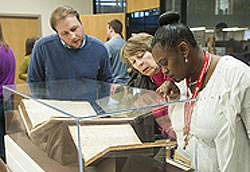 [photo, Research Archivist Tanner Sparks explaining rare documents on exhibit, Maryland Day Open House, State Archives, Annapolis, Maryland, March 2014]