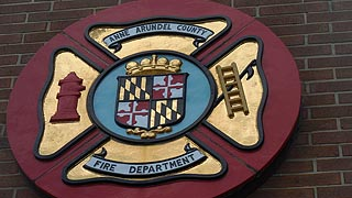 [photo, Anne Arundel County Fire Department emblem, 8495 Veterans Highway, Millersville, Maryland]