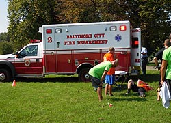 [photo, Fire Department personnel assisting injured football player, Patterson Park, Baltimore, Maryland]
