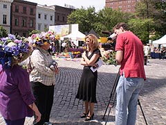 [photo, Local television crew interviews Baltimore Flowermart attendees, Mount Vernon Place, Baltimore, Maryland]