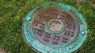 [photo, Howard County Sanitary Sewer manhole cover, Main St. and Ellicott Mills Drive, Ellicott City, Maryland]