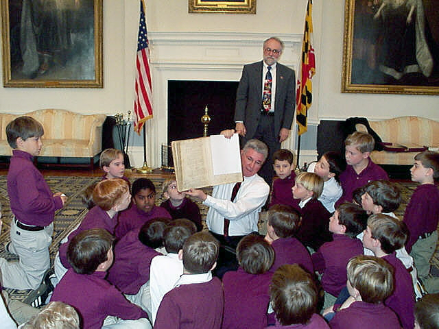 [Governor Glendening shows Act of Toleration to students]